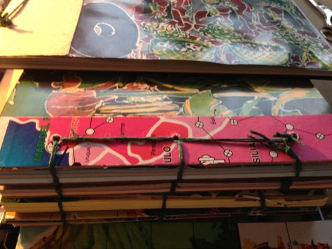 Scrapbook: assembly / stack of books (binding detail)
