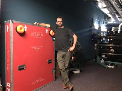 Jason Garnett, Roanoke Virginia Projectionist, in the projection booth at the Cinemark Paradise 24 in Davie Florida preparing to screen the Hateful Eight 70mm.