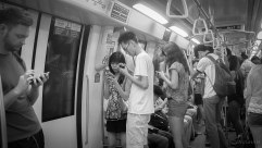 Silence while texting is rampant among Singaporians whether walking through a mall or riding the MRT subway.