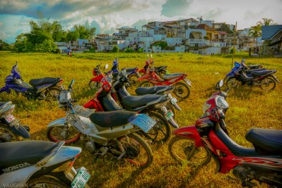 I could have picked two-dozen images from just this one day, the Day of the Dead. In the Philippines it is a day of honoring the departed on Halloween. The motor bikes eerily await the mourners return.