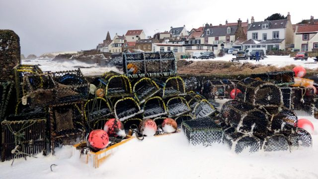 Creels in the snow, west pier, St Monans