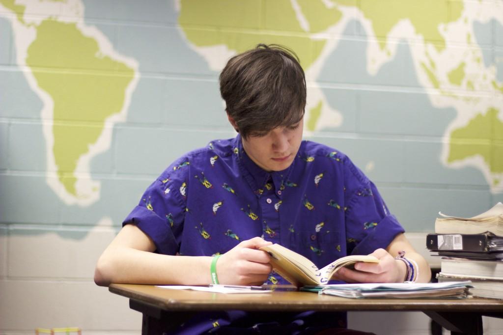Logan Reading Things Fall Apart