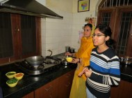 Learning how to cook lentils at a home-hosted dinner in Jaipur