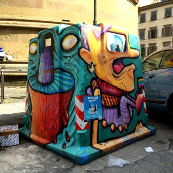 Modern art on the recycling bin in Florence