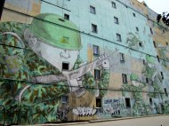 A window becomes a mouth in this mural, Warsaw, Poland
