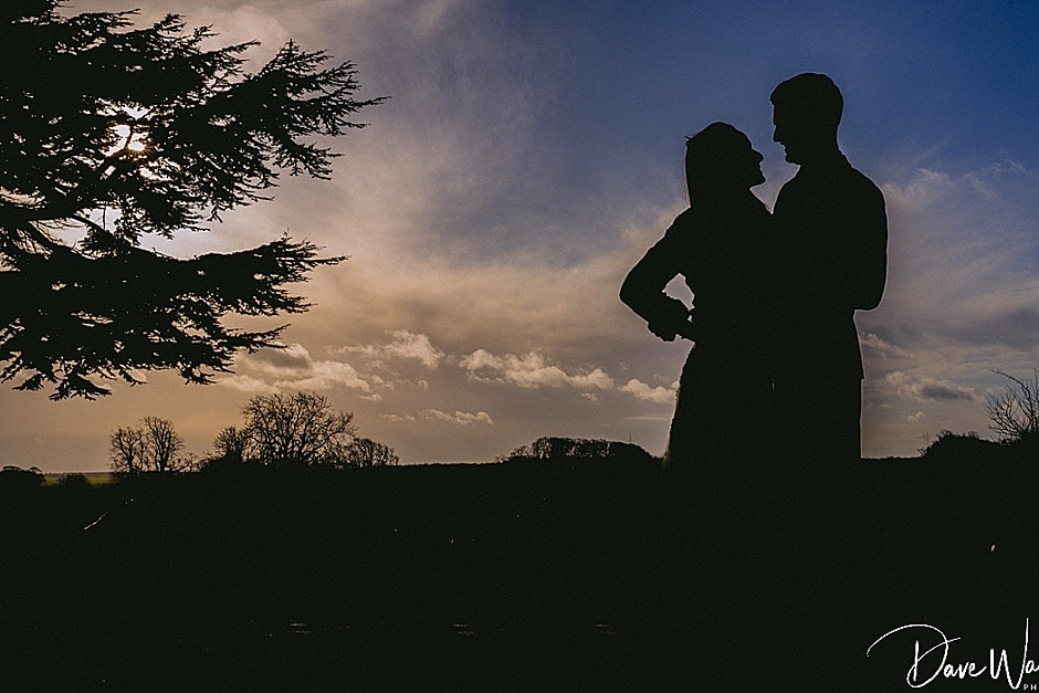 bride and groom at sunset at Hazlewood Castle