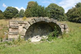 Whittling Well on Heath Common (West Yorkshire, UK). This is a large trough covered by an ornate stone arch.
