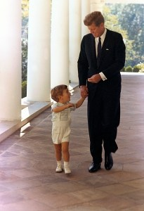 ST-C333-3-63   10 October 1963  President Kennedy and his son, John F. Kennedy Jr. White House, West Wing Colonnade. Photograph by Cecil Stoughton, White House, in the John F. Kennedy Presidential Library and Museum, Boston.