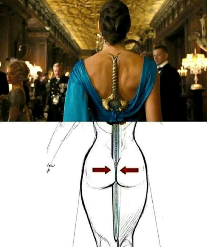 Image of Gal Gadot as Wonder Woman clenching her sword in her buttocks under a tight ball gown.