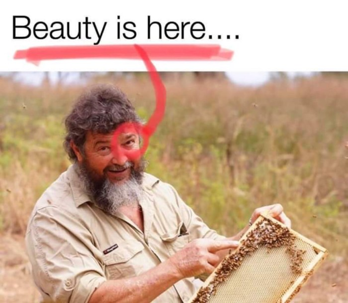 Picture of a beekeeper holding a bee hive. His eye is circled in red. Think about it.