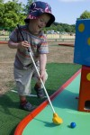Duncan playing crazy golf