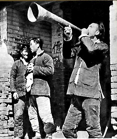 Gladys Aylward in Yangcheng - the Town Crier callling villagers to the Western Gate