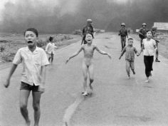 In this June 8, 1972 file photo, crying children, including 9-year-old Kim Phuc, center, run down Route 1 near Trang Bang, Vietnam after an aerial napalm attack on suspected Viet Cong hiding places as South Vietnamese forces from the 25th Division walk behind them. A South Vietnamese plane accidentally dropped its flaming napalm on South Vietnamese troops and civilians. (AP Photo/Nick Ut)
