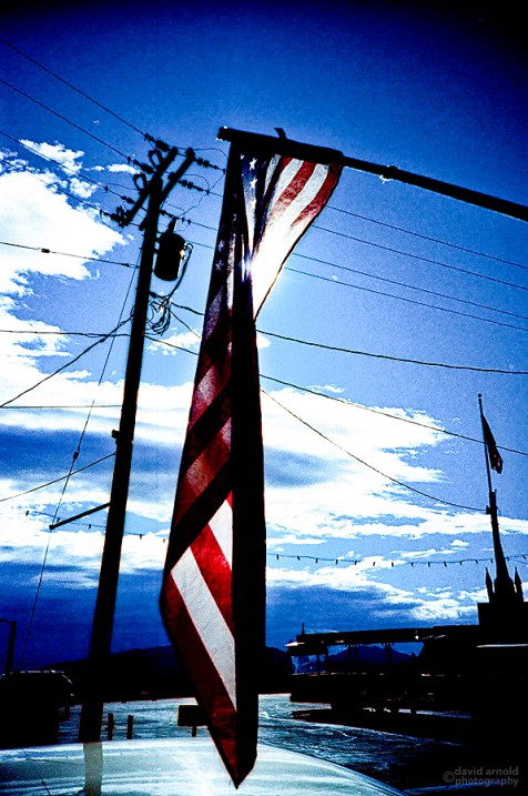Two American Flags, Virginia City, Nevada. (Kodak Ektachrome E-100G film, process C-41).
