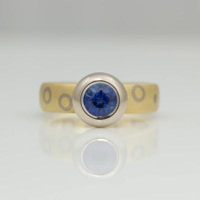 modern sapphire rub-over set gold ring