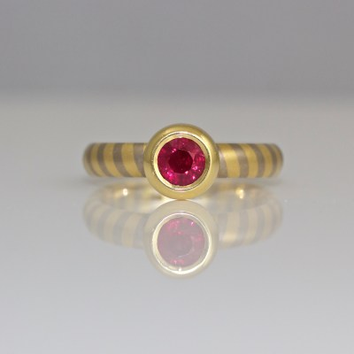 Ruby rub-over ring