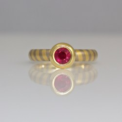 Ruby rub-over ring