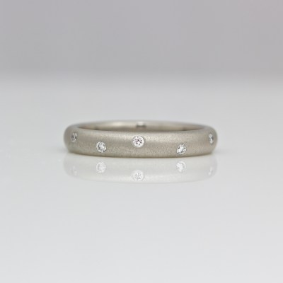 modern flush set diamond ring