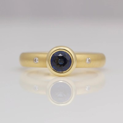 Sapphire engagement ring rub-over set