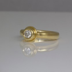 Diamond rub-over set yellow gold ring