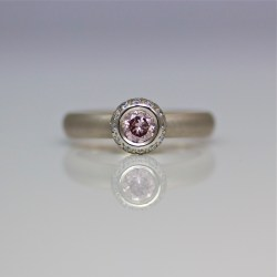 Contemporary pink diamond halo engagement ring