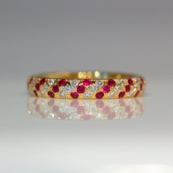 Rubies & diamonds flush set in yellow gold