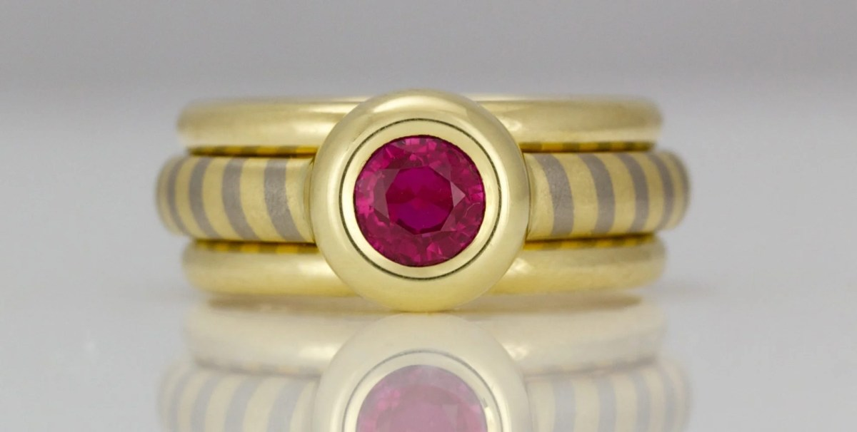 Ruby buyers guide, rub-over set ruby on diagonal stripe ring David Ashton