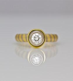 Diamond rub-over set on diagonal stripe ring