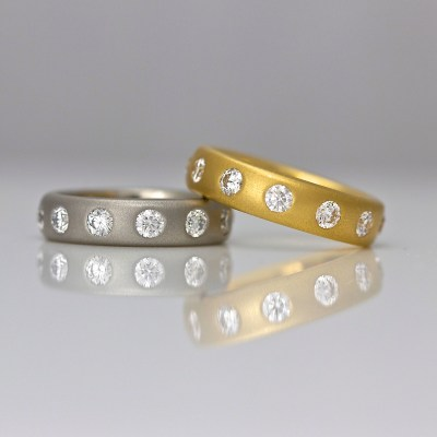 Contemporary diamond eternity ring yellow gold platinum.