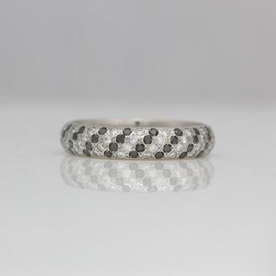 White & black diamond set eternity ring