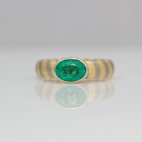 Perfect oval emerald on 18ct diagonal striped ring