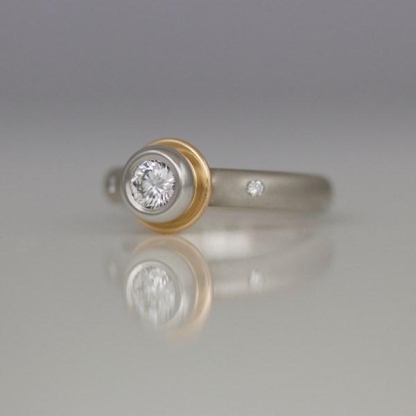 Platinum diamond solitaire with rose gold.