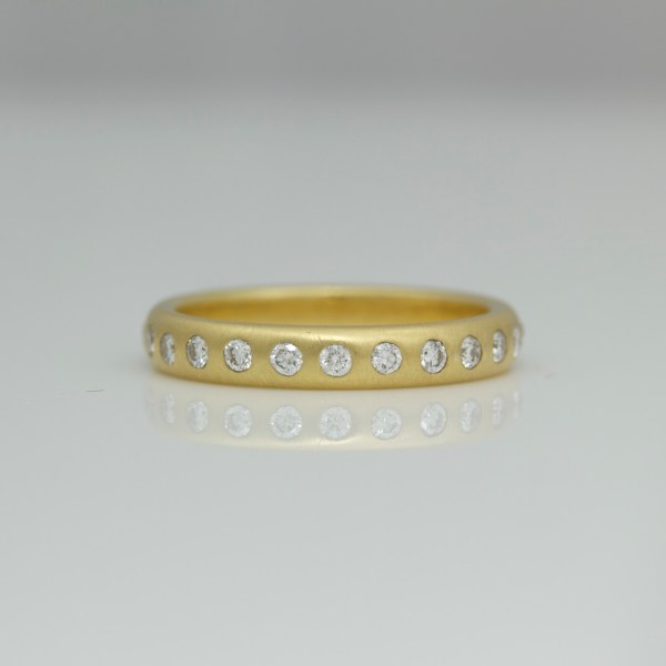 24 diamonds flush set in 18ct gold eternity ring