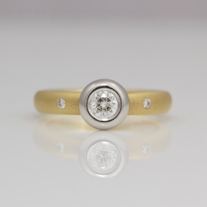 Diamond rub-over set Platinum & yellow gold ring