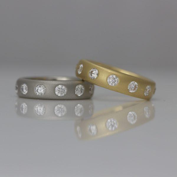 Modern diamond eternity rings in yellow gold & platinum