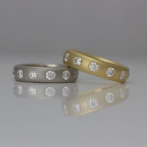 Modern diamond eternity rings in yellow gold & platinum