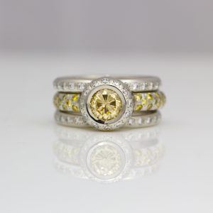 Natural yellow & white diamond stacking ring set in platinum