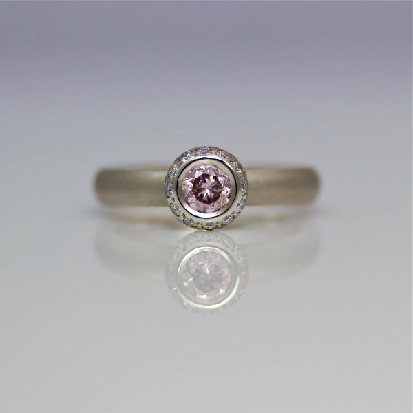 Pink & white diamond platinum engagement ring