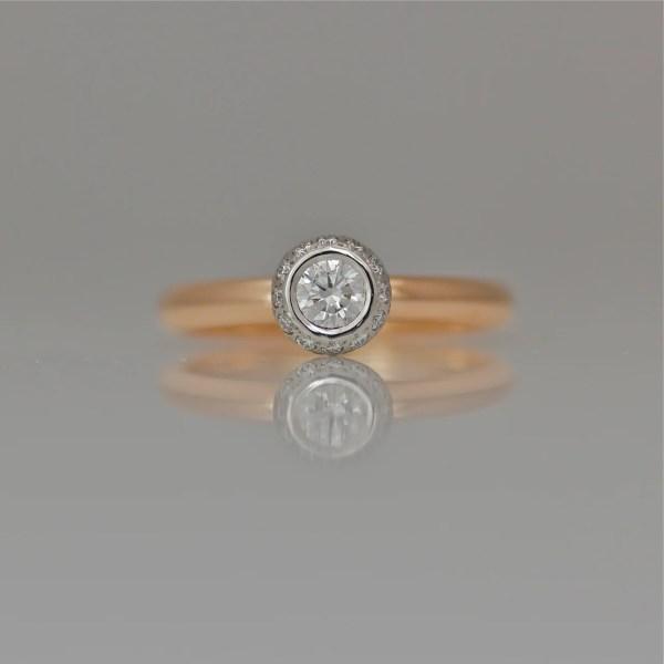 Diamond framed with diamonds set in Platinum on rose gold ring