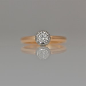 Diamond framed with diamonds set in Platinum on rose gold ring