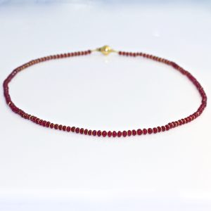 Vibrant red ruby & 18ct yellow gold necklace
