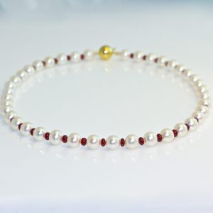 Opulent Ruby & pearl necklace