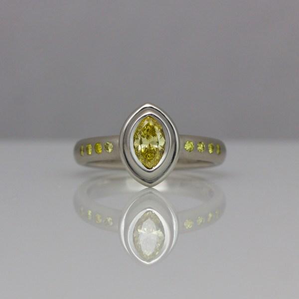 Natural yellow diamonds set in platinum ring