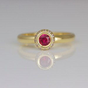 Ruby framed with diamonds 18ct ring