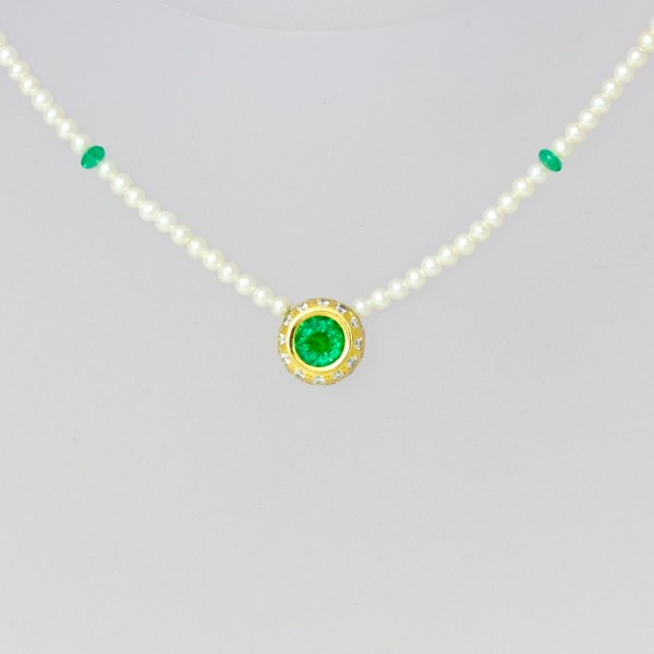 Emerald & diamond pendent on pearl necklace