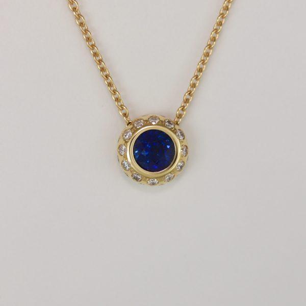 Sapphire with diamond halo pendent 9074