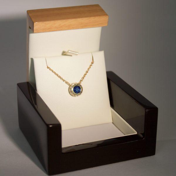 Sapphire diamond pendent in box