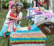 All ages give it a go at the tough piñata 8/5/17 Susanna Vapnek's residence