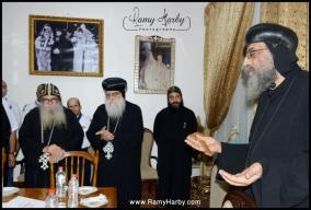 Pope Elect H.G. Bishop Tawadros stands at the head of the table and prays.