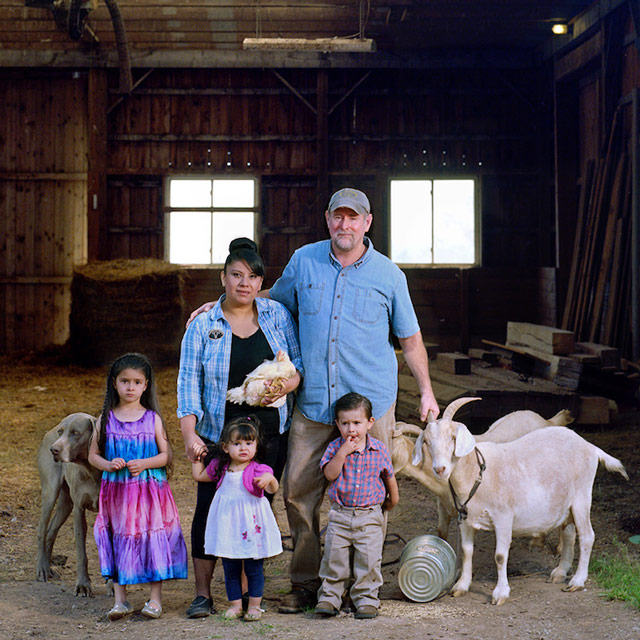 Family Farmers with Kids, Goat and Dogs